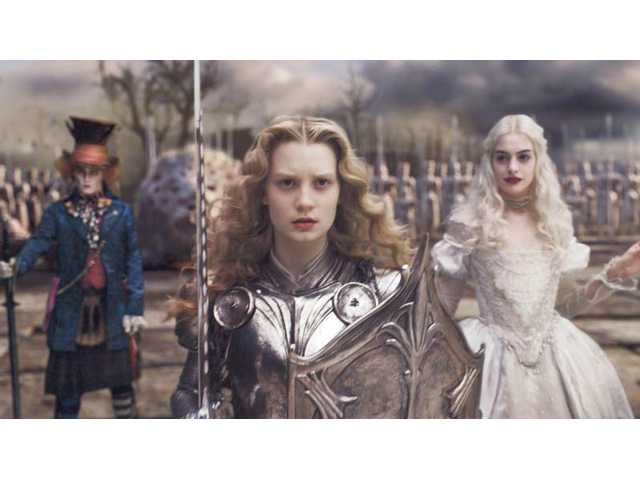 "Johnny Depp, Mia Wasikowska, center, and Anne Hathaway are shown in a scene from ""Alice in Wonderland."""