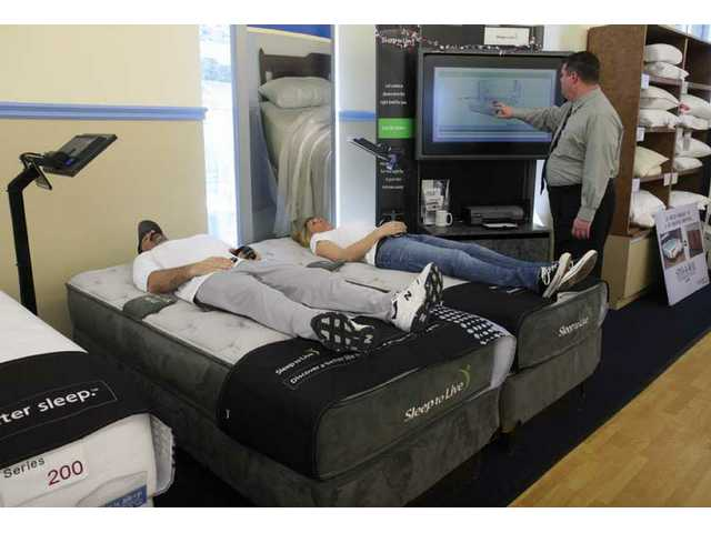 Customers test out a mattress at Sit 'n Sleep in Stevenson Ranch.