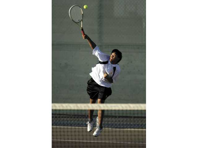 Golden Valley's Elbert Payra makes a serve during his second set against Littlerock. Payra didn't surrender a single point in three sets on Tuesday at home.