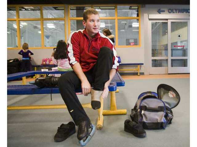 Chad Phillips, a 17-year-old student at Hart, puts on his skates Monday at Ice Station Valencia. Phillips will take part in the opening ceremony for the 2009 World Figure Skating Championships in late March at Staples Center.