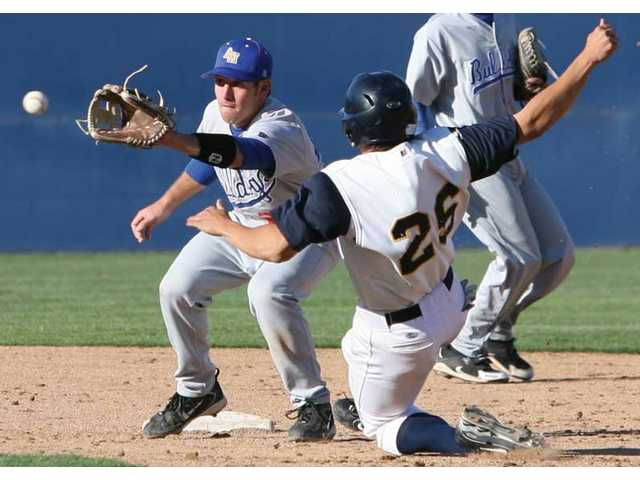 College of the Canyons designated hitter Jeremy Weber (26) is tagged out by Allan Hancock College second baseman Chris Malloy while trying to steal in the sixth inning on Thursday at COC. The Cougars lost the game 6-5.
