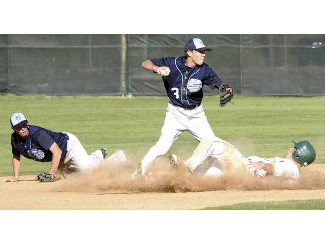 Saugus High junior shortstop Zachary Vincej (3) tries to finish off a double play March 30, 2007. Vincej recently verbally committed to Pepperdine University.