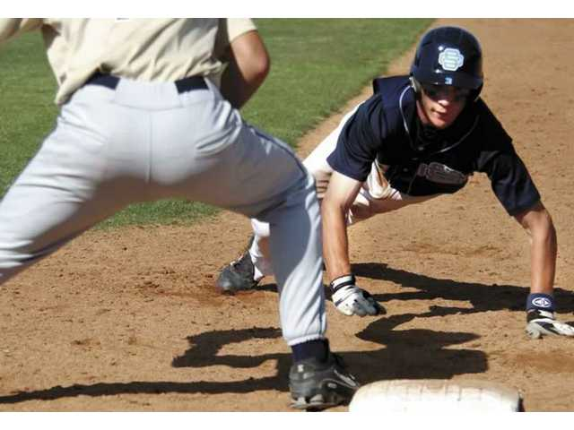 Saugus shortstop Zachary Vincej, right, slides back into first base April 27 against West Ranch. Vincej, just a junior, has accepted a scholarship from Pepperdine.