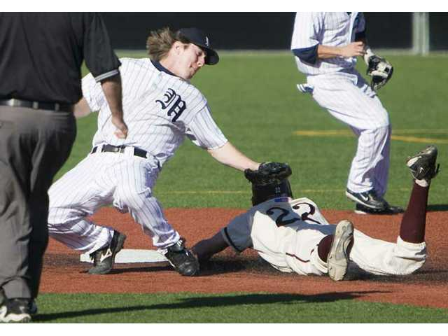 The Master's College's Joseph Zeller, left, tries to tag Westmont's Colten Christianson Thursday.