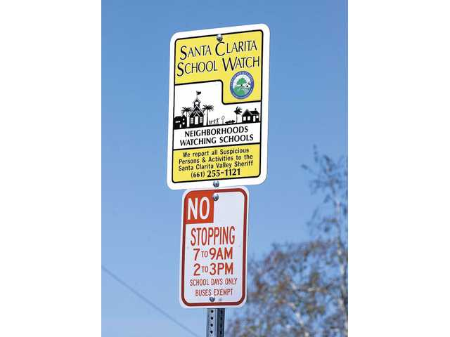 Signs for the new Santa Clarita School Watch Program have been erected next to Leona Cox Elementary School in Canyon Country.