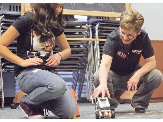 SCV Zonta Club member Sue Peterson, right, and Hart High student Kani Ebner test their robot after building and programming it at the Boys & Girls Club of Santa Clarita Valley on Feb. 26.