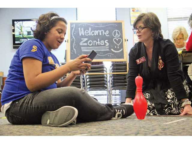 Arroyo Seco Junior High School student Jovana Fitzgerald and SCV Zonta Club President Cindy Kittle calculate measurements in order to program their robot at the Boys & Girls Club of Santa Clarita Valley. The Zonta robotics event was presented to girls at the Newhall facility of the Boys & Girls Club to encourage interest in math and science. Nearly 40 girls have benefited from the program since the Zonta grant was awarded.