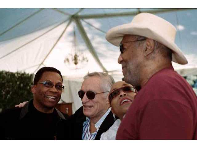 Herbie Hancock, Hugh Hefner, Dee Dee Bridgewater and Bill Cosby share a moment at Playboy Mansion Feb. 27, when the artist lineup for the June Playboy Jazz Festival was unveiled.