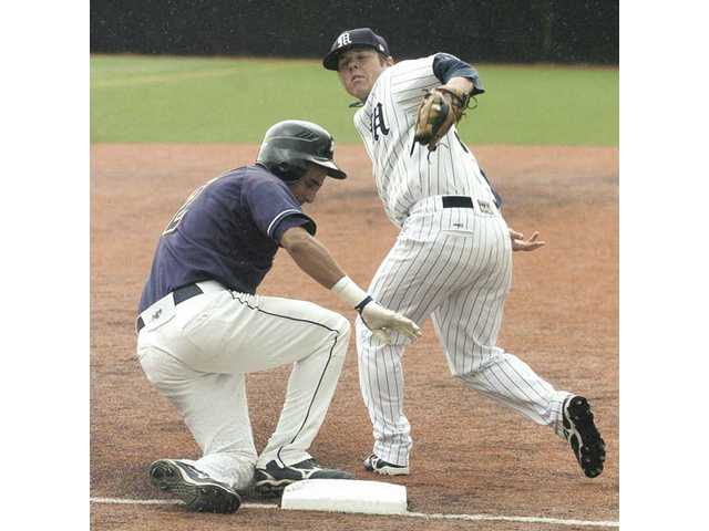 The Master's College third baseman Henry Price, right, attempts to make the tag on Vanguard pinch runner Bryce Arroyo, left, in the ninth inning on Saturday at TMC. The Mustangs won the game by the score of 3-2.