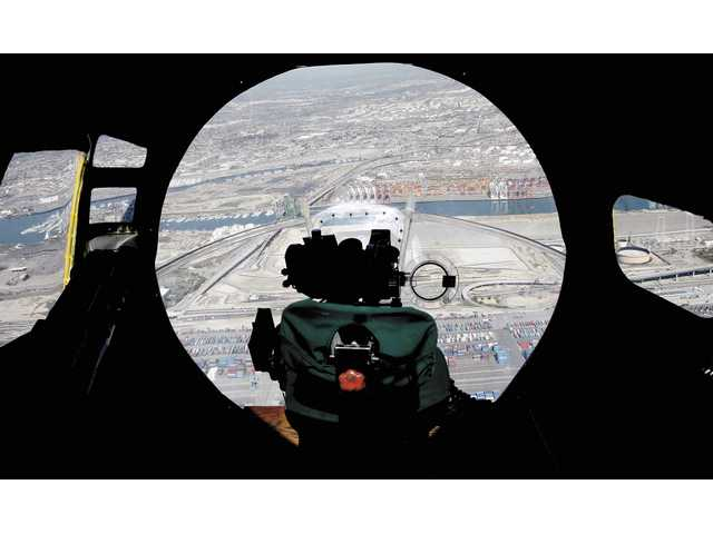 A view of the Long Beach area Monday from inside the bombardier's compartment of the Liberty Belle, a restored B-17G bomber. Built at the tail end of World War II, the plane never saw combat and is a clone of a bomber that flew numerous missions with the 390th Bomb Group based in Framlingham, England.