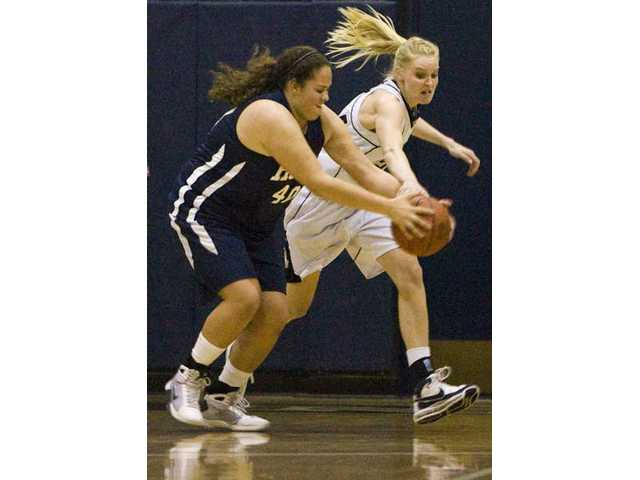 The Master's College's Stacy Nanninga, right, tries to steal the ball from Hope International's Aundrea Hyde Jan. 17 at Bross Gymnasium.