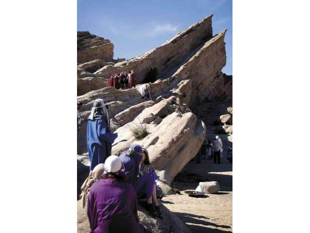Actors gather at Vasquez Rocks county park in a dress rehearsal for Easter sunrise services.