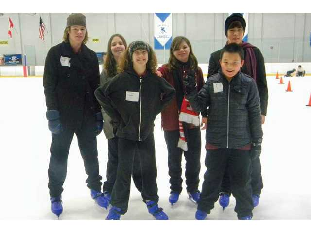 Christian Cranert, Jenna Irvin, Jenny Cranert, Jenna Irvin, Andrew Chang, and Matt Lee enjoy ice skating lessons through Monticello Preparatory School.