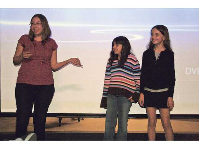 Film instructor Maria Garcia, left, with film students Abril Jimenez, center, and Michaela Purser during the SCV Film Festival held earlier this year. Students in the After School Enrichment and Safety program at Newhall Elementary School have organized a series of humanitarian projects to help people in need around the world.