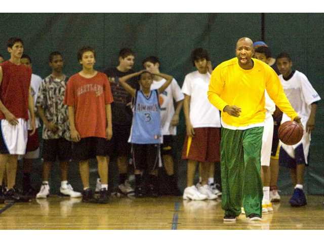 "Former NBA star Kenny Smith runs ""Aim High,"" a youth basketball foundation that teaches kids the fundamentals of the sport out of the Powerhouse Gym."