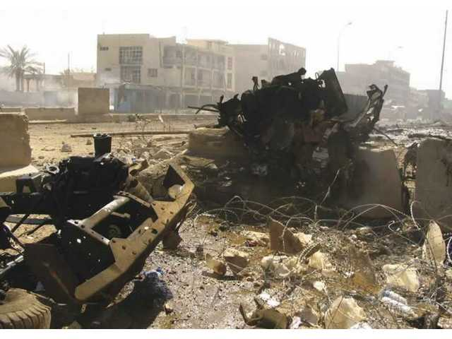 A photo shows what was left of the dump truck that a suicide bomber drove into a hotel occupied by an Army platoon in Ramadi, Iraq. Army Spc. Jon Morita was thrown about 10 feet by the force of the explosion. He says concrete barriers saved the soldiers; only the driver was killed in the massive explosion, which was videotaped as a how-to for aspiring terrorists.