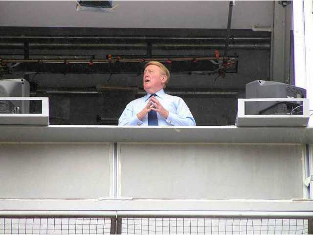 "Vin Scully, voice of the Dodgers on radio and TV since the team was based in Brooklyn, leads fans in a rendition of ""Take Me Out to the Ball Game"" at SCV Dodgers Day 2008."