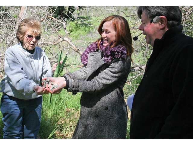 Vice President of the Placerita Nature Center Association Ron Kraus, right, watches as docents in training Bess Barber, left, and Tischia Bluske find a bunch of onions and a bag of gold for the re-enactment of the discovery of gold Under the Oak of the Golden Dream event Tuesday.