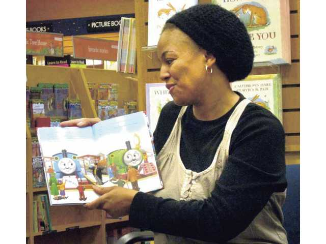 "Kim Fields reads a ""Thomas the Tank Engine"" book to a group of children Saturday at the Valencia Borders bookstore. Fields, an actress and Valencia resident, has been reading to young children at the bookstore every Saturday at 11 a.m. since January."