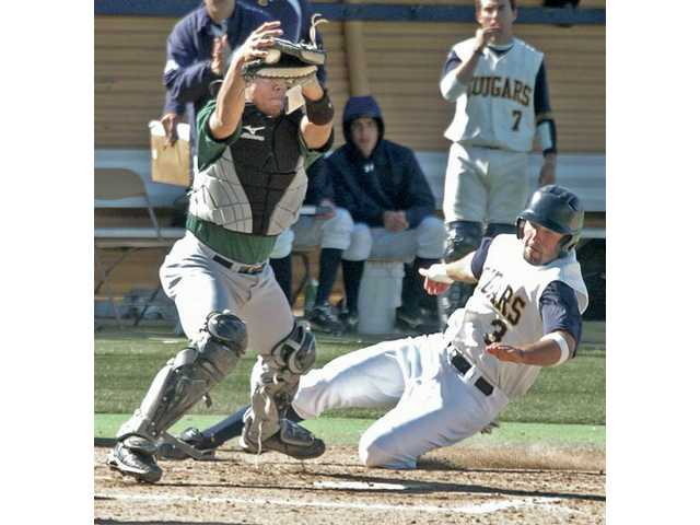 College of the Canyons' Cal Voglesang (3), right, of College of the Canyons beats the throw to Los Angeles Valley College catcher Del Mario Elam (35) to score the second run for COC in the first inning of a 5-2 win over Valley College on Tuesday at COC. The Cougars