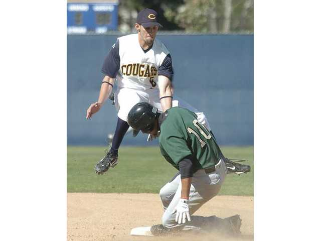 College of the Canyons' Sean Sweeney attempts a tag as he recovers from a high throw on Valley College's Sean McGrier on Tuesday at COC. The Cougars won 5-2.