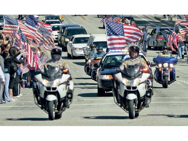 The funeral procession moves down Copper Hill Drive in Saugus on Saturday.
