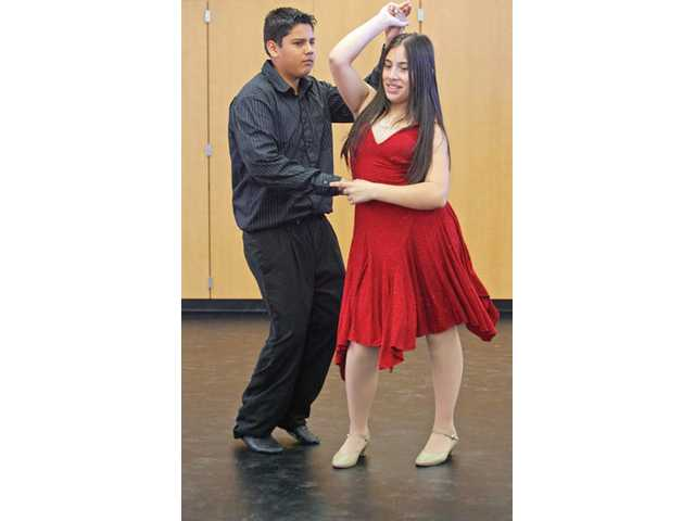 Placerita Junior High School seventh-graders Jaqueline Portillo and Jesus Gonzalez practice their merengue moves after school on Wednesday afternoon. The couple along with other 10 others will participate in the High Desert Dance Classic event this weekend.