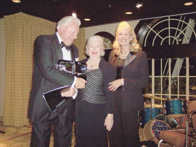 Left to right, Harold and Jacquie Petersen of Valencia, are awarded the Silver Spur Award for Community Service by COC Chancellor Dianne Van Hook at the Beverly Wilshire Hotel in Beverly Hills.