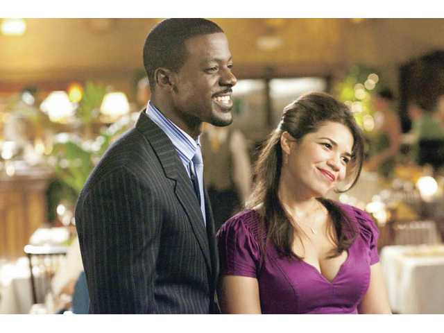 "Lance Gross, left, and America Ferrera are shown in a scene from Fox Searchlight's ""Our Family Wedding."""