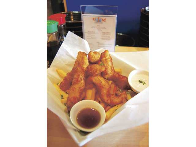 The tender, flaky tempura-battered fish and chips at Fish Tail Seafood Market & Grill are just $6.95 and come with malt vinegar and a delicious, creamy, house-made tartar sauce.