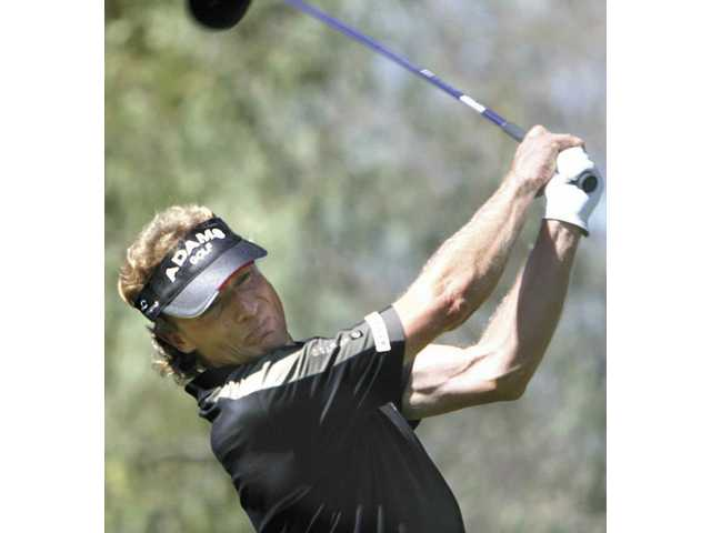 Champions tour golfer Bernhard Langer tees off on the 11th hole at Valencia Country Club Tuesday. Langer, a two-time Masters winner, will be golfing in the AT&T Champions Classic, which begins Friday, for the first time.