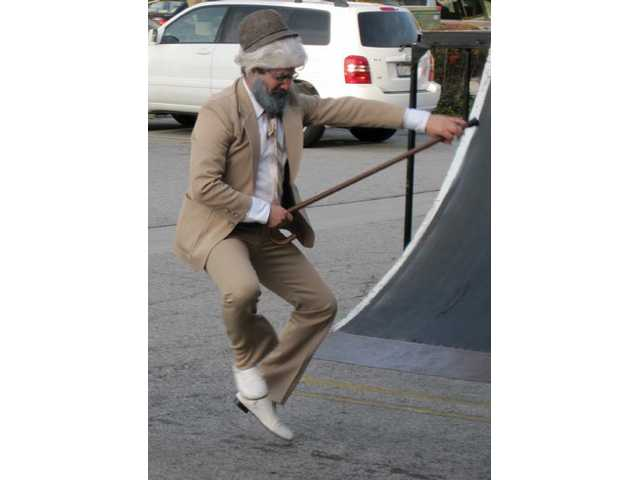 Rabbi Choni Marozov shows off his dancing moves at Chabad of SCV's Purim Party on Sunday, Feb. 28.