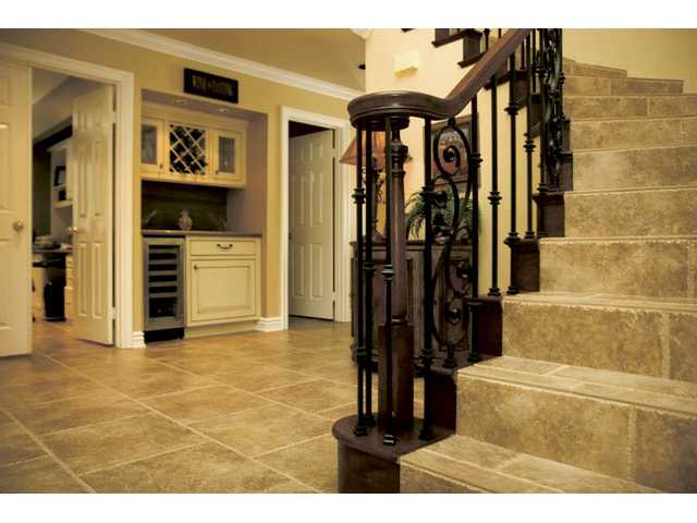 The remodeled entryway to the Wilk home and the stairwell display an elegant, clean design.