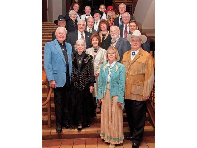 Most of the Silver Spur honorees from the previous 19 years joined Gary and Myrna Condie, front row, this year's recipients, on the stairs of the Gene Autry Western Heritage Museum.
