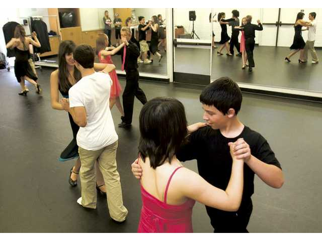 Participants of the after-school ballroom dancing program at Placerita Junior High School practice the cha-cha before the 5th annual High Desert Dance Classic competition this weekend.