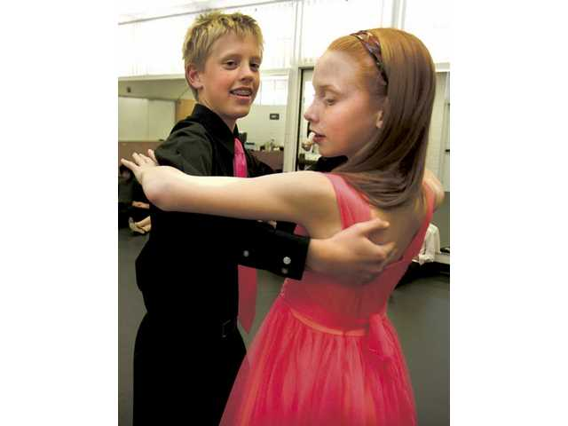 Placerita Junior High School students David Van Name and Chelsea Smith dance the waltz.