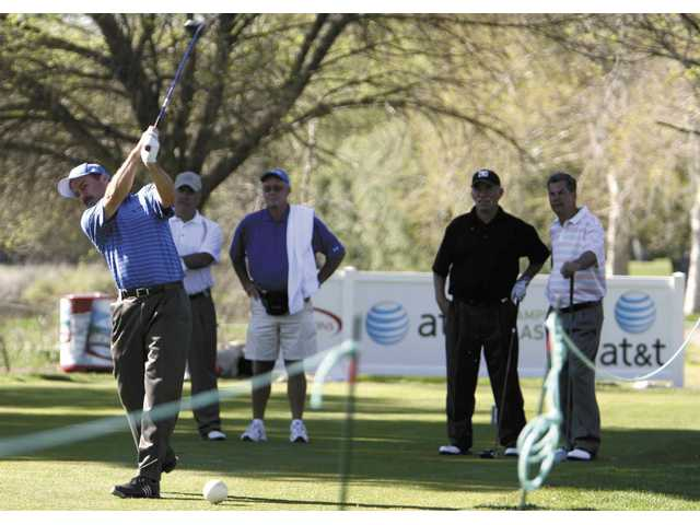 Golf tourney brings dollars to local charities