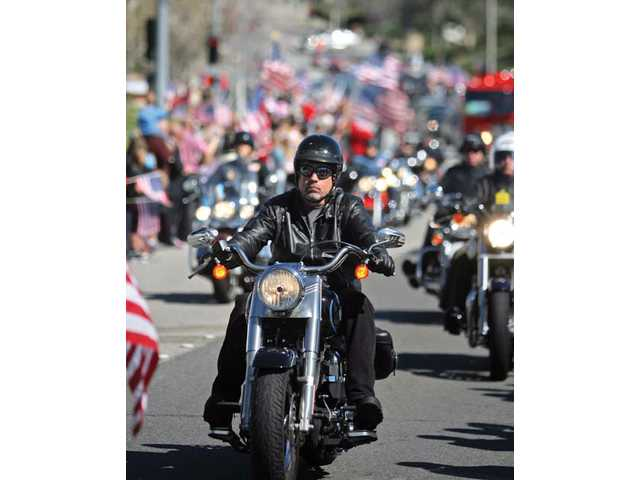 Members of the Patriot Guard Riders ride in the procession for fallen local soldier Sgt. Ian T.D. Gelig on March 13 in Saugus.