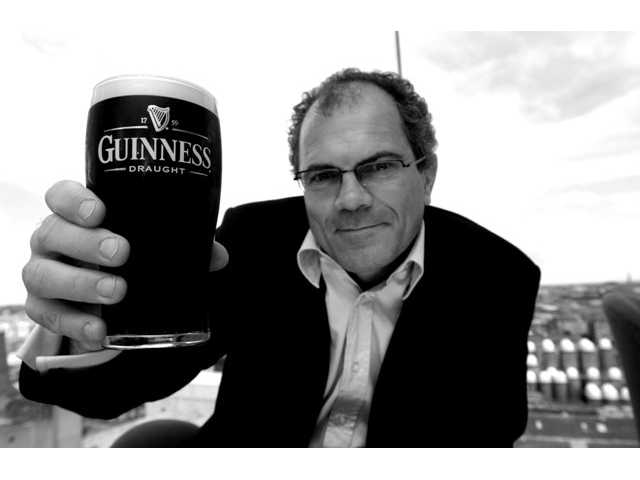 Guinness brewmaster Fergal Murray holds a pint of Guinness in the Gravity bar at the Guinness Storehouse in Dublin. The storehouse is one of Dublin's most visited tourist attractions.