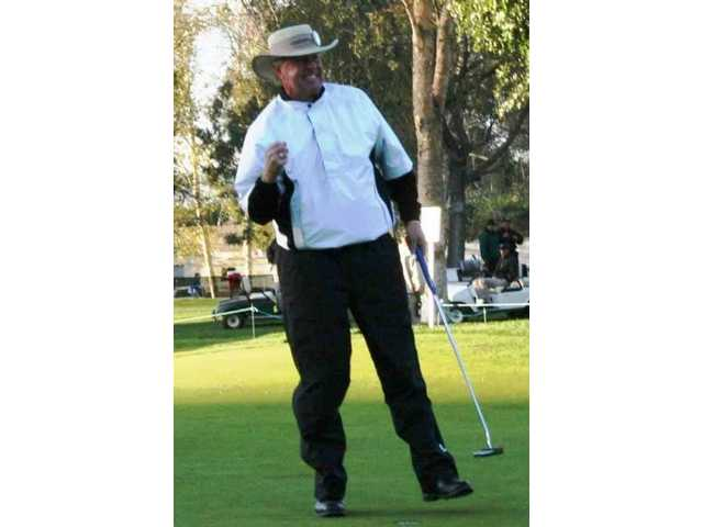 Denis Watson celebrates dropping the winning putt on the 10th hole in the sudden death playoff to win the 2008 AT&T Champions Classic golf tournament at Valencia Country Club.