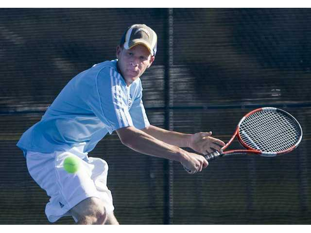 Saugus singles player Marc Liff prepares to hit a return to Quartz Hill's Paul Whang (not pictured) in a match Friday at Saugus High School.