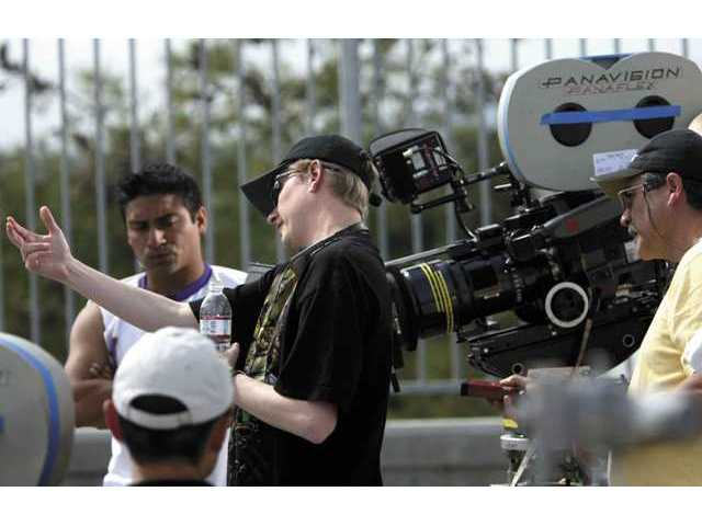 "Ray Griggs, a writer, producer, director and actor from Simi Valley, discusses camera angles in preparation for filming a scene from ""Super Capers,"" which is set for release later this year."