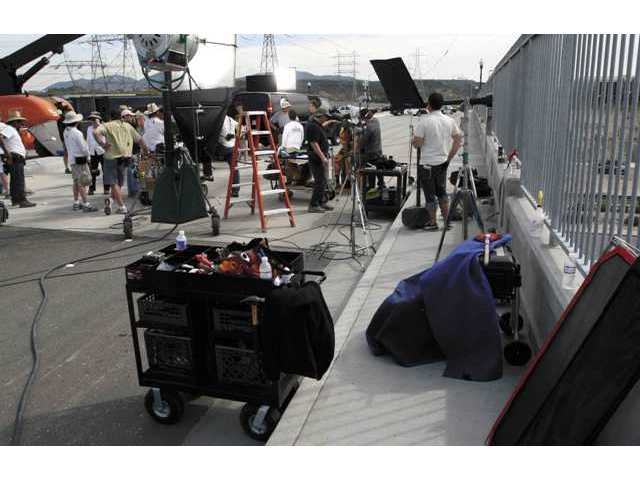 "Scenes from the upcoming indie film ""Super Capers"" is being filmed on the Golden Valley Bridge over Soledad Canyon Road in Canyon Country this week."