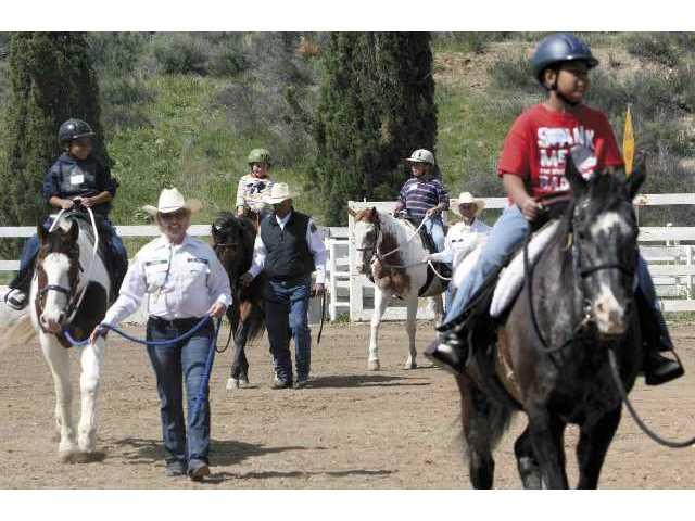 A group of Val Verde children learned about horses and had the opportunity to ride them in a Sheriff's Posse program Saturday.