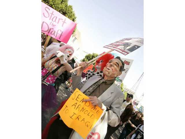 A man in an Arnold Schwarzenegger marches down Hollywood Boulevard Saturday to protest the Iraq War.