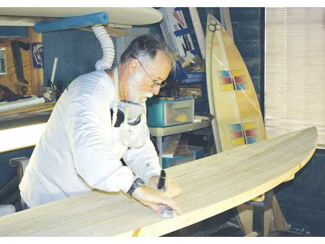 Ray Moss, 61, from Valencia, started getting serious about building custom surfboards in the 1990s. He currently operates his business out of a shop off of Ruether Avenue in Canyon Country.