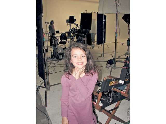 Merit Leighton on set of a Cox Cable commercial. Leighton was honored with a Child Actor Recognition Event (CARE) Award during a red-carpet ceremony at Universal Studios Hollywood on March 14.