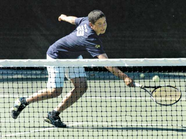 West Ranch High's No. 3 singles player Ali El-Arabi reaches to volley against Granada Hills High on Tuesday at West Ranch. The Wildcats took an early lead but struggled to finish and fell 77-76 on games, after ending with a 9-9 tie on sets.