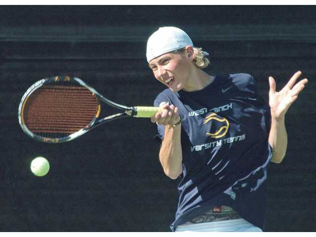 Baron Von Kessler of the West Ranch High School tennis team competes in a non-league match against Granada Hills at West Ranch on Tuesday.