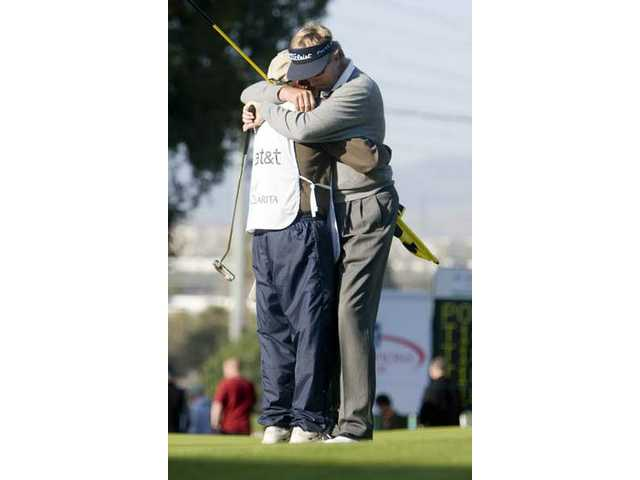 Dan Forsman hugs his caddy after winning the AT&T Champions Classic Sunday afternoon at Valencia Country Club. Forsman defeated Don Pooley in a playoff on the 18th hole to win the event.